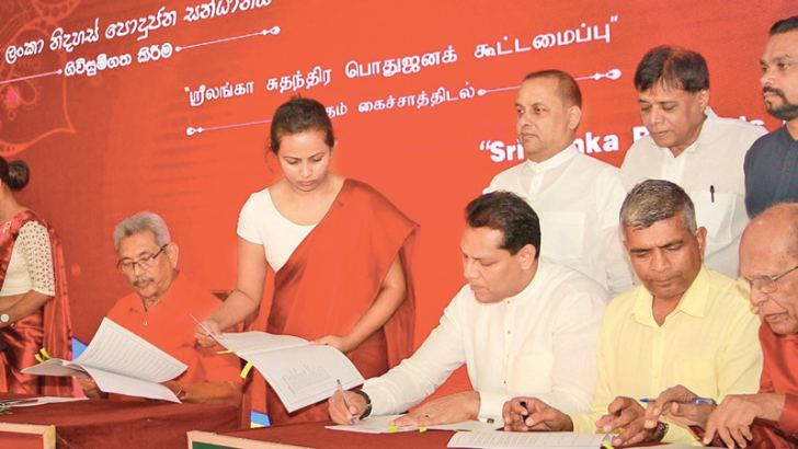 Political party representatives signing the agreement.  Picture by Dushmantha Mayadunne