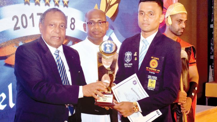 Asela Madushan who was  adjudged Sportsman of the Year 2018 receiving  his award from Chief Guest Cuthbert Charles at the Josephian Colours Day. St. Joseph's College Rector Father Ranjith Andradi  is also in the picture.  Picture by Gayan Pushpika