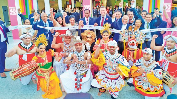 Minister John Amaratunge, Sri Lanka High Commissioner in UK, Manisha Gunasekara, WTM Director Simon Press with the Sri Lankan Dancing Troupe at the opening of the WTM pix by Sudath Malaweera