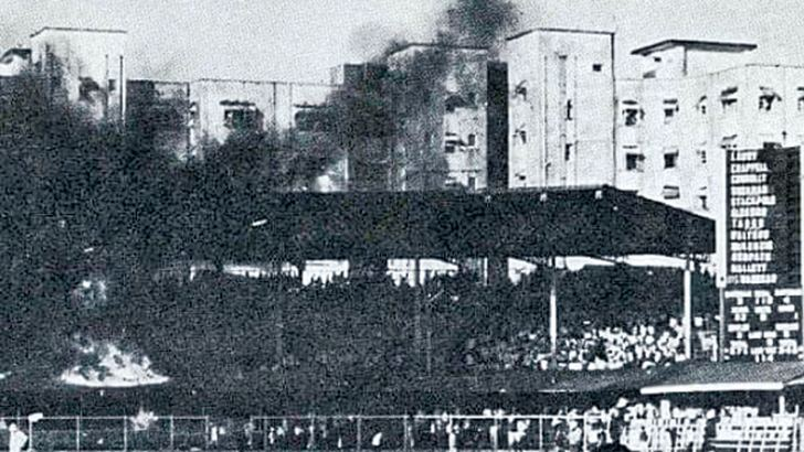 Fire spreads in a stand at the Brabourne Stadium in Mumbai, after crowd trouble erupted during the first Test against Australia in 1969