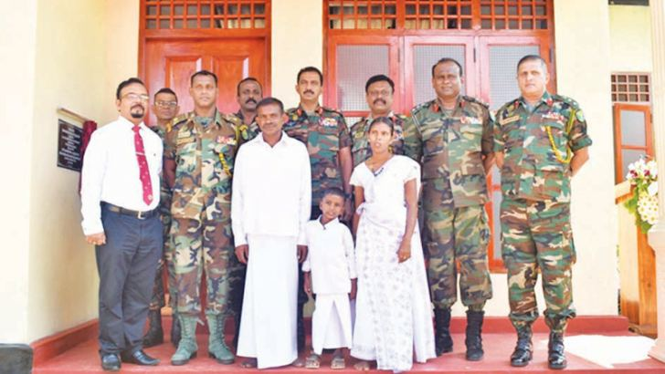 The Karunarathne family along with Army officials at the house he received. Nimal Wijesinghe,  Anuradhapura Additional District Group Corr.