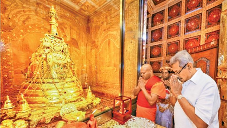 President Gotabaya Rajapaksa,as he begins his presidency, visited Kandy yesterday.Here he pays homage to the Casket of the Sacred Tooth Relic in the inner sanctuary of the Sri Dalada Maligawa. (Picture courtesy Dalada Maligawa Media Unit)