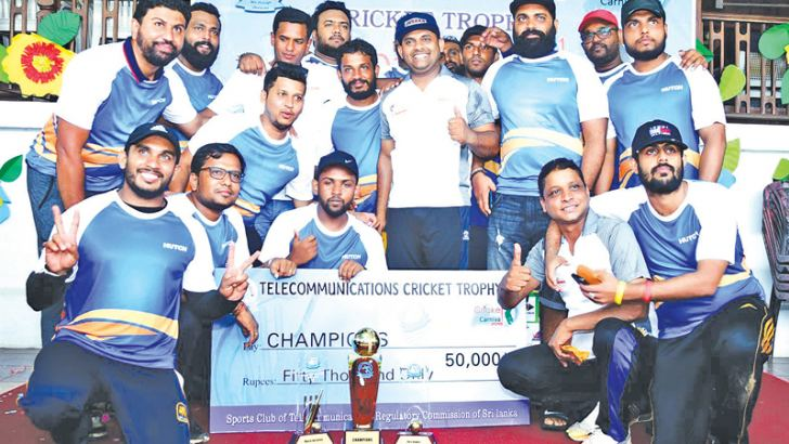 Champion Hutch Telecommunication team with their trophies