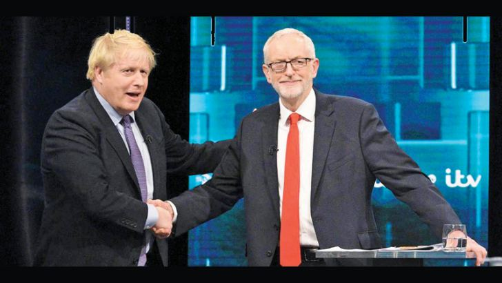 British Prime Minister Boris Johnson and Opposition Labour Party leader Jeremy Corbyn shake hands before their first TV clash of the 2019 General Election campaign.