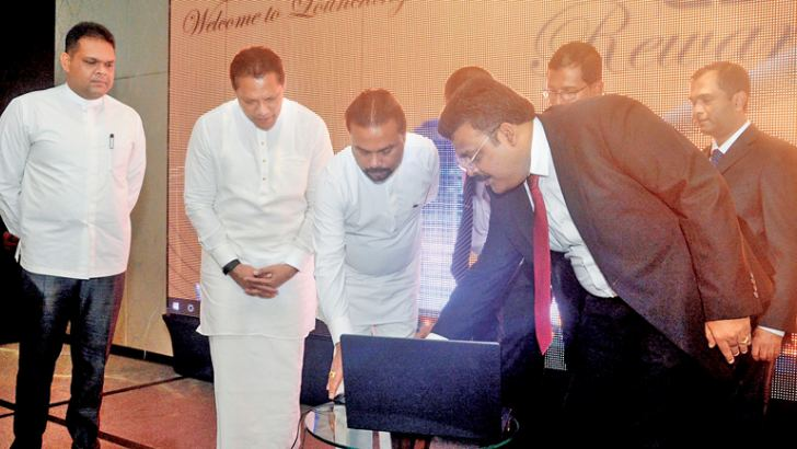 Minister Wimal Weerawansa and State Ministers Dayasiri Jayasekara and Shehan Semasinghe at the launch of the CBA Rewards special discount card introduced by the Colombo Businessmen's Association, at the Movenpick Hotel in Colombo 3 yesterday. Picture by Samantha Weerasiri