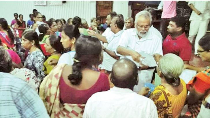 Minister Douglas Devananda with the participants of the meeting. Picture by Rasula Dilhara Gamage, Northern Province Special Corr.