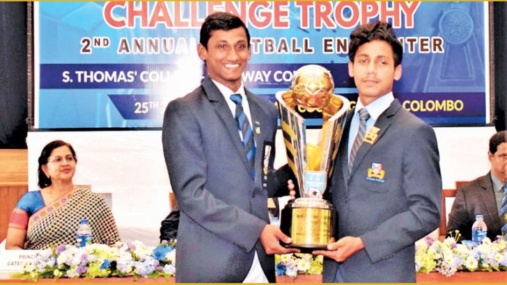 The Two Captains Shevan Ebenezer of S. Thomas' College, Mount Lavinia and Areeb Niyas of Gateway College poses with the 'Neville De Alwis - Ralph Alles' Challenge Trophy at the Press conference held at S. Thomas' College main auditorium on Thursday. Picture by Herbert Perera