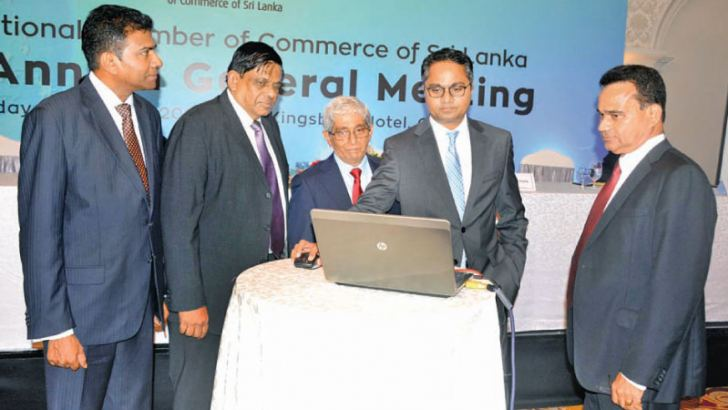 The National Chamber of Commerce of Sri Lanka launched fromSriLanka.com platform, aimed at supporting Sri Lankan companies promote its products and services in the global market. Here the website launced by Chamika Godamanna flanked by Prof W D Laksman, NCCSL President Asela de Livera and officials of NCCSL. Picture by Sudath Malaweera