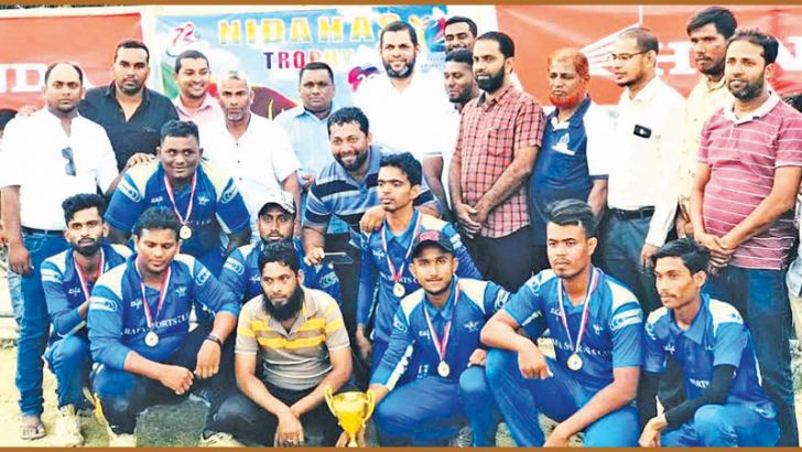 Champions Rafa SC team with their trophy and the guests.