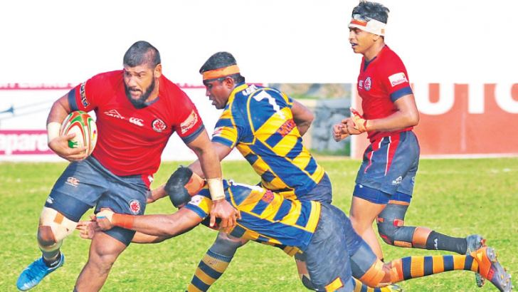 CR & FC captain with ball in hand trying to evade a tackle from Army defenders. Picture by Wasitha Patabendige