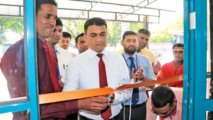Ceylinco General Insurance Limited Ampara Manager N.G.C. Gunarathna opens the service centre