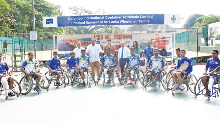 CICT CEO Jack Huang, SLTA president Iqbal Bin Issac and players of the Sri Lanka wheelchair tennis team