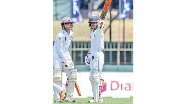 Isipathana's saviours skipper Leshan Amarasinghe (on left) and Savindu Uthsara who rescued the side with a fifth wicket stand of 117 runs on the   first day of the Battle of the Brothers cricket encounter against Thurstan at the SSC grounds yesterday.