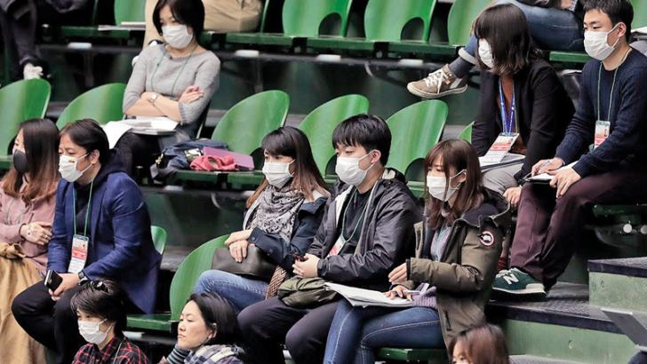 Members of the media wearing face masks are seen during the singles match between Yasutaka Uchiyama of Japan and Roberto Quiroz of Ecuador on day one of the Davis Cup qualifier at the Bourbon Beans Dome in Miki, Hyogo, Japan. The two-day qualifier was held behind closed doors due to the novel coronavirus outbreak.