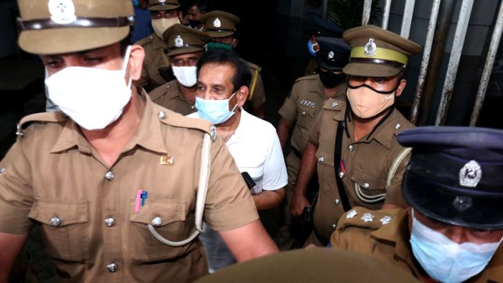 Former Health Minister Rajitha Senaratne being escorted from the CID Headquarters last night.  (ANCL Photo Desk)