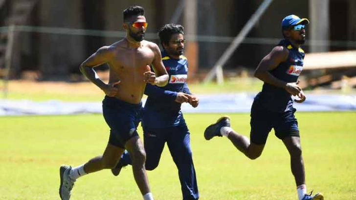 Sri Lanka cricketers Isuru Udana, Kusal Perera and Vishwa Fernando train at the CCC grounds. (Ishara Kodikara, AFP)