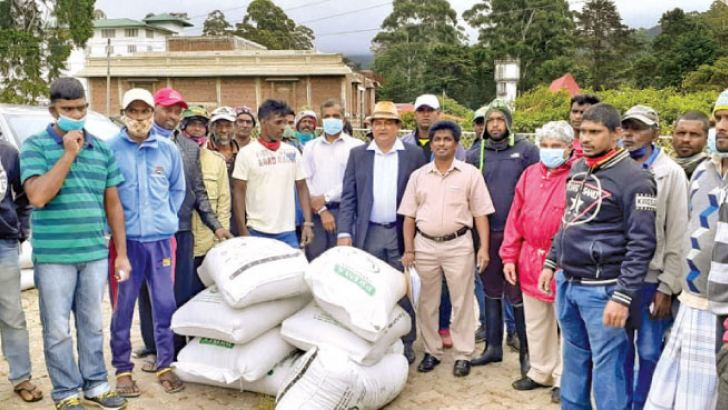 President of Sri Lanka Equestrian Association Suranjith Premadasa (Centre) at the animal food distribution in Nuwara Eliya.