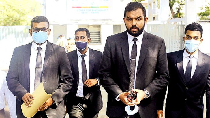 Attorney-at-Law Pasan Weerasinghe and a group of lawyers after handing over the petition at the UN compound in Colombo 7. Picture by Sulochana Gamage.