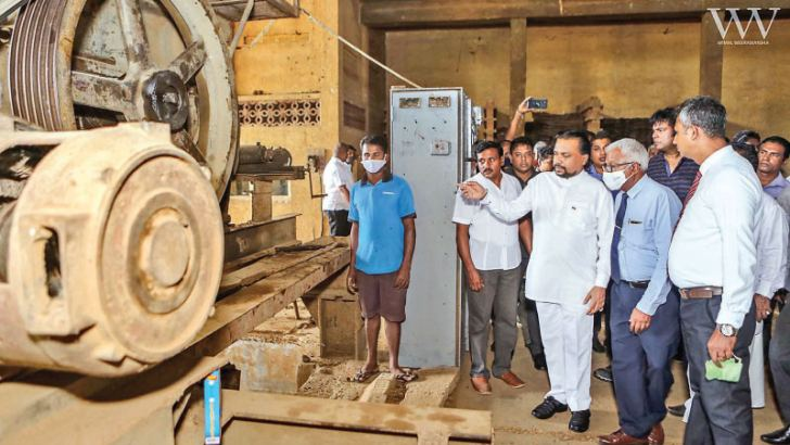 Minister Wimal Weerawansa, Ceylon Ceramic Corporation Chairman Jude Fernando and other officials at the re-commissioning of the Mahiyanagana roof tiles factory.