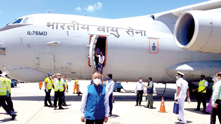 Indian High Commissioner to Sri Lanka Gopal Baglay poses near the cargo plane in which he arrived with a consignment of medicine