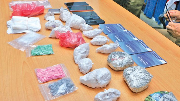 The heroin and ecstasy pills taken into custody in Boralesgamuwa yesterday.  Picture by Sameera Abeysinghe.