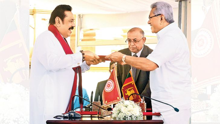 Mahinda Rajapaksa took oaths as the first leader to become Prime Minister for a fourth time in the history of Sri Lankan politics before President Gotabaya Rajapaksa at the historic Kelani Raja Maha Viharaya yesterday.President's Secretary Dr.P.B Jayasundera looks on. Picture by Wimal Karunatilake.
