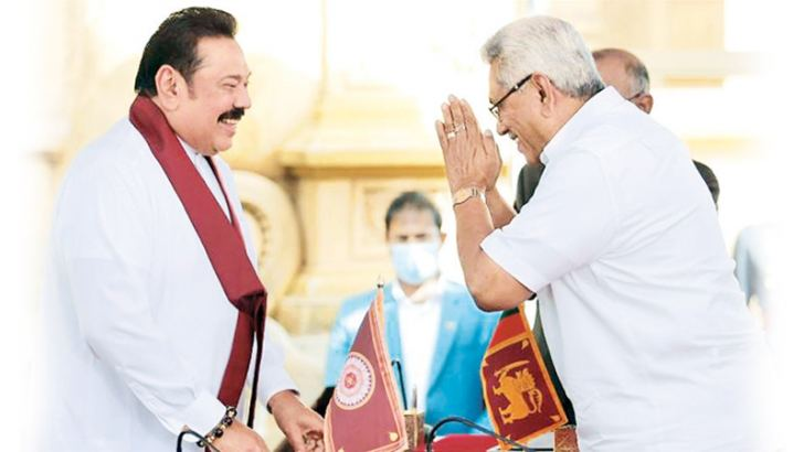 Mahinda Rajapaksa takes oath as Sri Lankan PM for the fourth time from  President Gotabaya Rajapaksa yesterday.