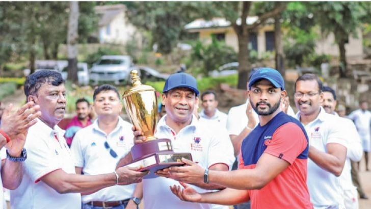 Captain of the 2012 group  Chanaka Ratnayake receiving Champion trophy from Chapa Weeraratme. Tissa Jayasinghe is also in the picture. Pictures Upananda Jayasundera-Kandy Sports Spl.Corr.