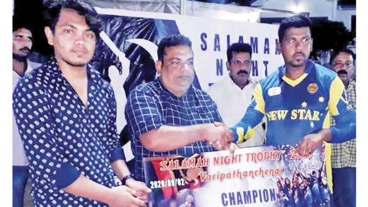 The skipper of the Champion New Star SC receiving the trophy and Rs.40,000. cash prize