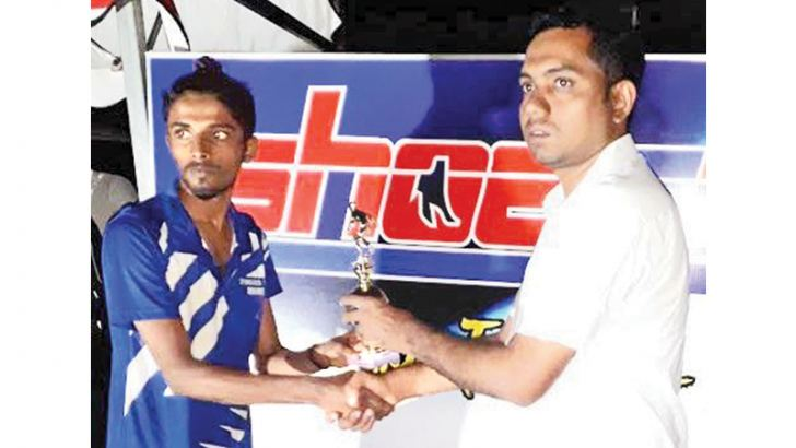 Man of the match M.A.M.Rizad of the Irakkamam IRFC Sports Club receving the trohy.