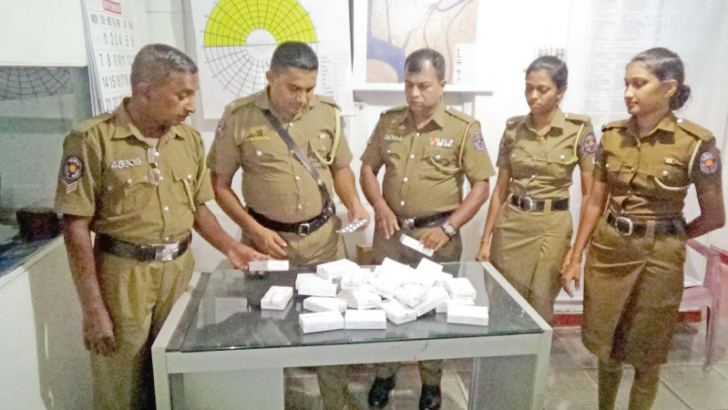 Police with the seized contraband. Ragama Group Corr.