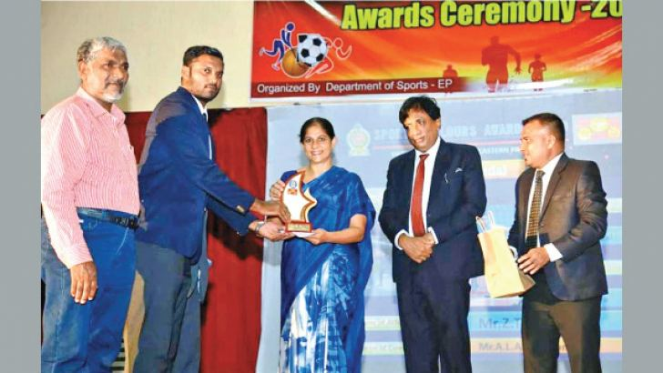 Eastern Province Governor Anuradha Yahampath giving away a trophy to a South Asian Games medol winner