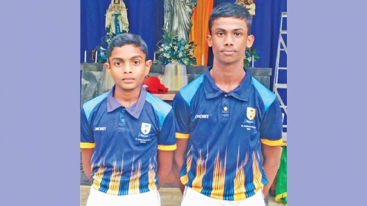 Shanel Thimana on left and Harsha Weerasooriya on right posed for a photograph just after the match at St. Anthonys College Grounds, Wattala. (Picture by Dilwin Mendis Moratuwa Sports Special Correspondent)