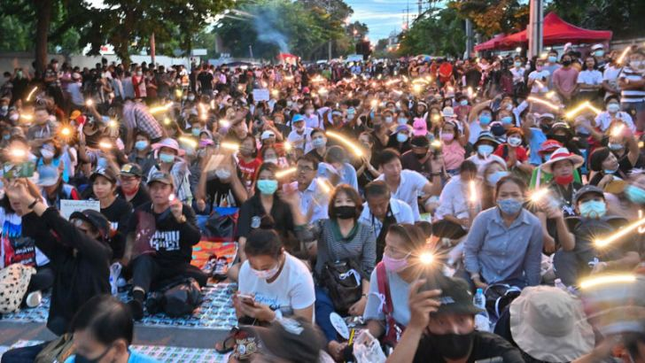 Anti-Government protesters take part in a pro-democracy rally outside Thailand's Parliament in Bangkok on Thursday, as activists gathered to demand a new Constitution. - AFP