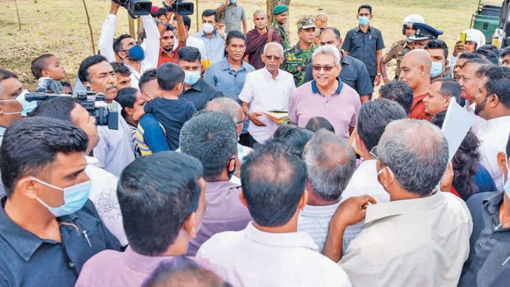 President Gotabaya Rajapaksa listening to the problems faced by the people in Welanvita village in the Haldummulla DS division. Picture courtesy Presidential Media Division