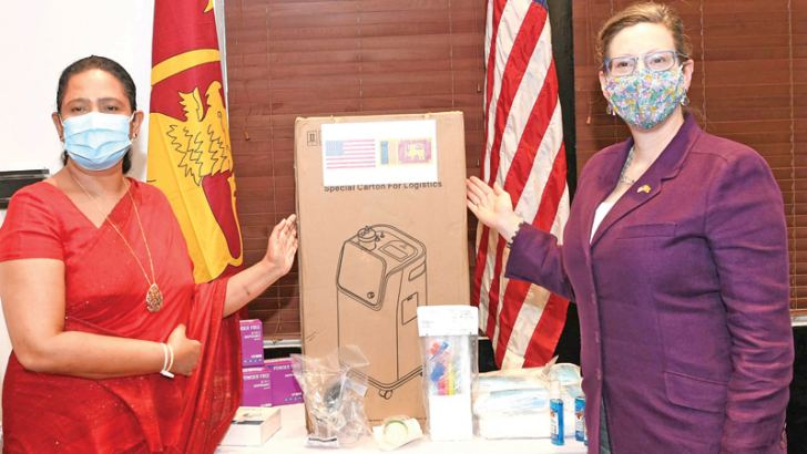 Health Minister Pavithra Wanniarachchi and US Ambassador Alaina Teplitz with a part of the donation.