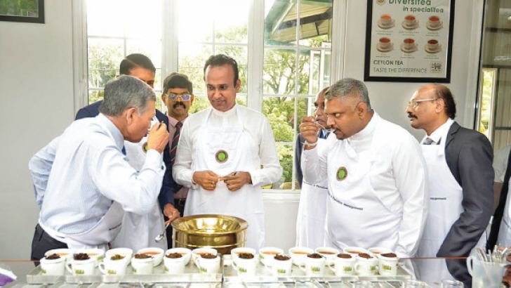 Ministers and nipm officials at Tea tasting.      Picture by Vipula Amarasinghe