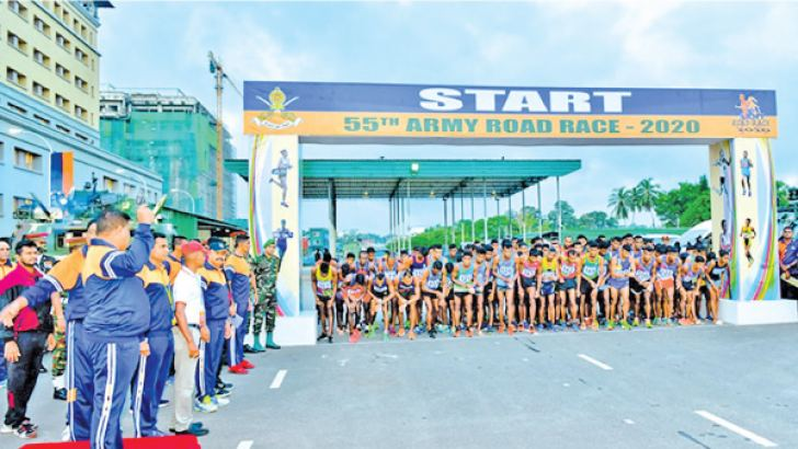 Army Commander Lt General Sahavendra Silva delivering starting orders at the Amy annual road race