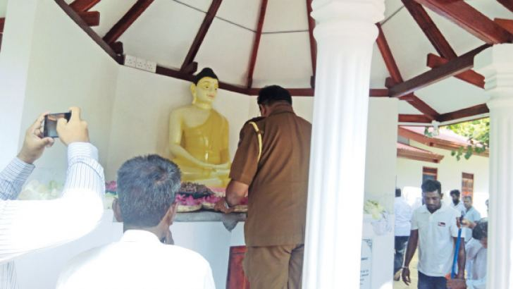 The Madukanda OIC at the shrine room of the newly constructed temple.