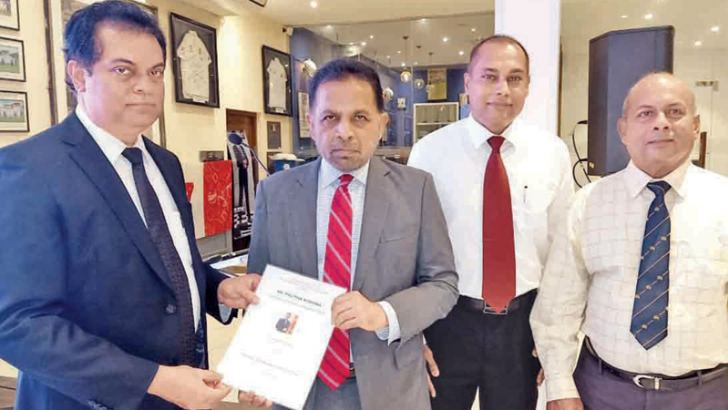 Dr. Palitha Kohona Diplomatic Training Scholarship award by the Colombo Silk Road Professionals and Industrialists Forum was launched. Here Vice President, W. S. Weeraman, Dr. Kohona, Secretary, Nishan  K. Silva and President, Ajith Dharmawardena at the event.