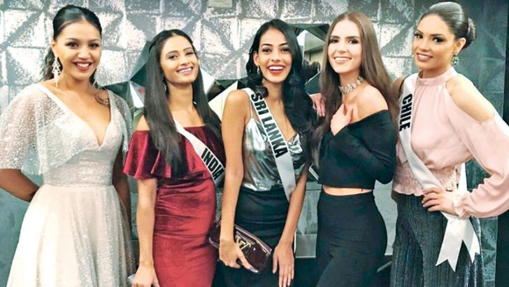 With some of the other beauty contestants of Miss Universe 2017