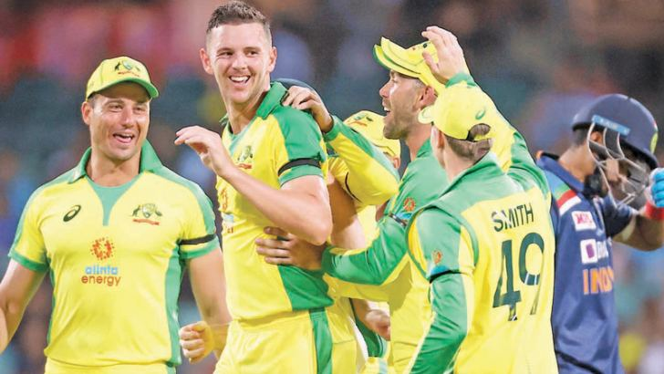 Australia's Josh Hazlewood (C) celebrates with teammates after taking the wicket of India's Shreyas Iyer (R) during the one-day international cricket match at the Sydney Cricket Ground (SCG) in Sydney on November 27.