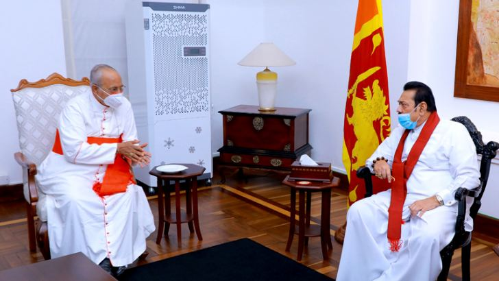 His Eminence Malcolm Cardinal Ranjith paid a courtesy call on Prime Minister Mahinda Rajapaksa at Temple Trees yesterday. Picture courtesy Prime Minister's Media Division