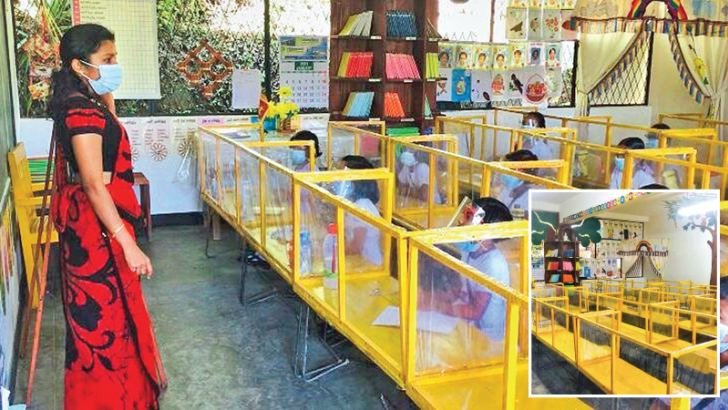 Covered desks provided for each child in the classroom. A session in progress at a hygienically designed classroom. (Pictures by Mahinda P.Liyanage).