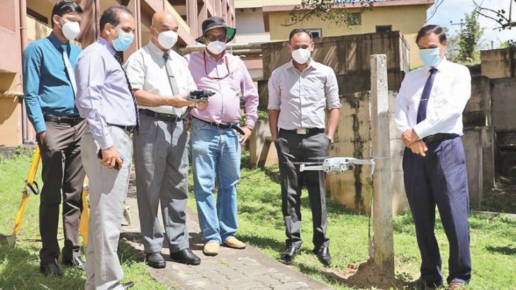 Kandy Chief Surveyor S.N. Edirisinghe and the team initiating drones for land measuring..