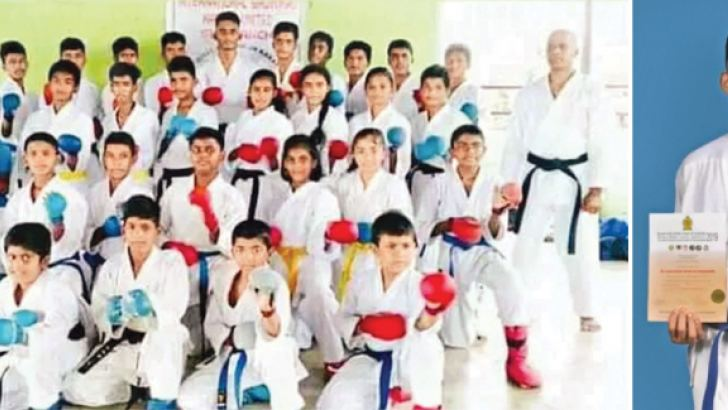 The Karates of ISKU Academy posed for a photograph after receiving their grading Karunananda Kavindu Vishmitha is standing sixth from left at the last row. (Picture by Dilwin Mendis Moratuwa Sports Special Correspondent)