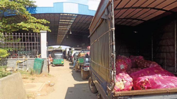Vehicles arriving at the Dambulla Dedicated Economic Centre with vegetables.