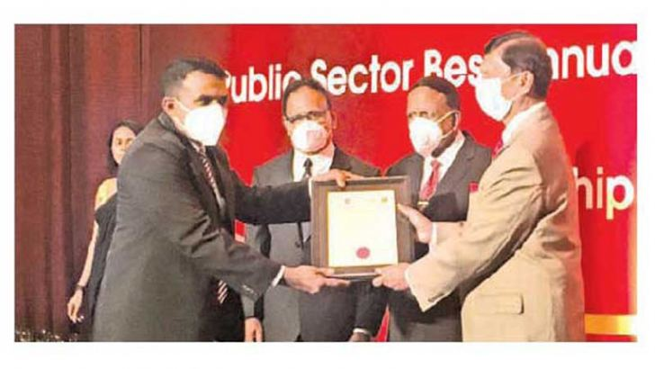 State Minister Ajith Nivard Cabraal hands over a certificate of participation. Picture by Dinesh Perera.
