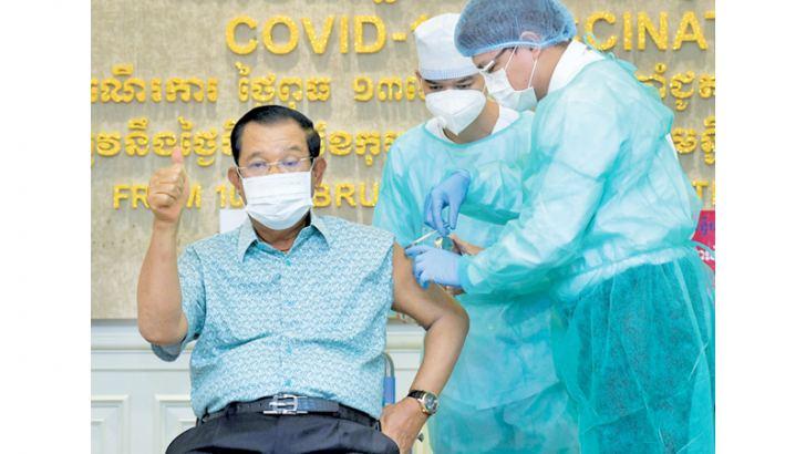 Cambodian Prime Minister Hun Sen gestures as he receives the AstraZeneca vaccine during a vaccination campaign against the COVID-19 coronavirus at Calmette hospital in Phnom Penh on Thursday. - AFP