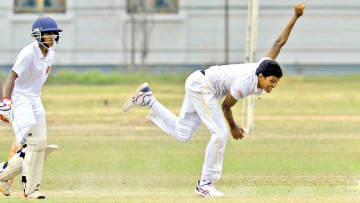 Royal College's Gishan Balasooriya bowls against Trinity College during the second day of their Inter-Schools Under-19 match on Friday. Picture by Hirantha Gunathilaka.